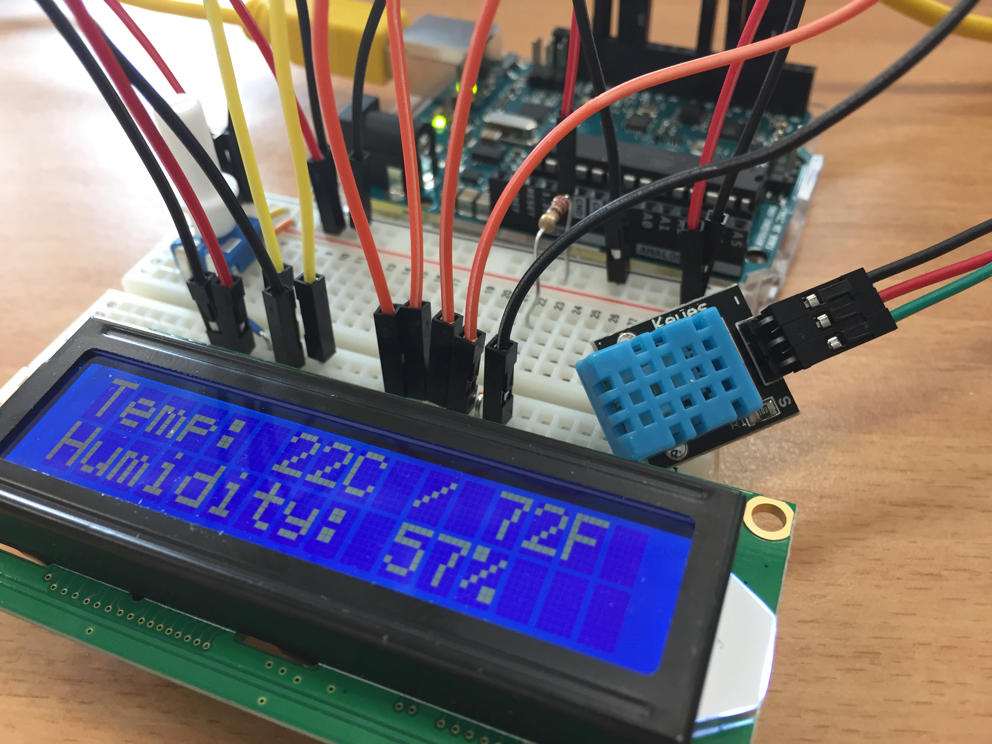 Arduino Uno with DHT11 temperature and humidity sensor data displayed on LCD